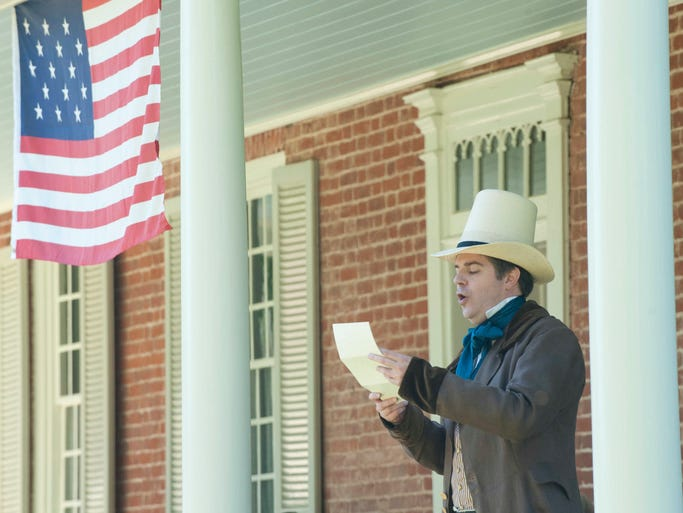 Keith Stevenson portraying Dr. John Croghan, son of the builder of Locust Grove, reads the Declaration of Independence at the Independence Day celebration at Locust Grove. 04 July 2014