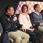 In this Feb. 23, 2016, file photo, Tennessee head football coach Butch Jones, second from left, speaks during a news conference in Knoxville, Tenn.  From left are women's basketball coach Holly Warlick, Jones, track & field/cross country coach Beth Alford-Sullivan, swimming and diving coach Matt Kredich, and diving coach Dave Parrington.