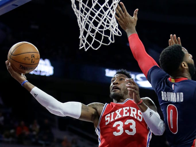 Philadelphia 76ers' Robert Covington (33) goes to the