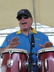 Islander Steve Reynolds plays congas with duo Gary and Kerri in this file photo.