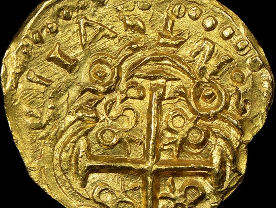 One of the 2 escudos denomination gold coins struck