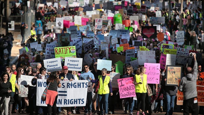 An estimated crowd of over 9,000 people march along Second Street from the Shelby County Courthouse to the National Civil Rights Museum in downtown Memphis during The Memphis Women's March as cities all over the country host similar protests in the wake of President Donald Trump's inauguration. Some speculate that it could be the largest march the city has seen since the Civil Rights marches of the 1960s.