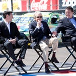 Professional race car driver Andy Lally tells the story of what got him hooked on racing: the 1988 Bud at The Glen at Watkins Glen International. He was one of two drivers who spoke Friday at the road course's ribbon-cutting ceremony to unveil the new track surface. Sitting in chairs behind him are FOX Sports broadcaster Bob Varsha, racing legend Derek Bell, WGI President Michael Printup, Sen. Tom O'Mara and Corning Enterprises President G. Thomas Tranter.