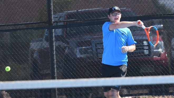 Pueblo West High School senior Christian Kruger hits a forehand against Discovery Canyon during the No. 4 doubles match on Sept. 11 at Pueblo West.