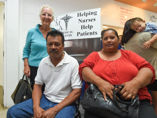 Anne Cummings, left, drove her neighbors Betro Reyes, who is blind, and his wife Norencia Reyes to the Tamuning Senior Citizen Center for free medical service provided by the Guam Medical Association on April 22, 2018.