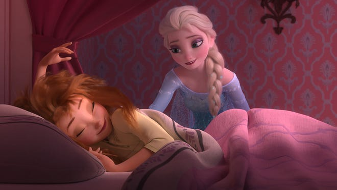 Anna (voiced by Kristen Bell) wakes up to a very special birthday party hosted by big sister Elsa (Idina Menzel) in a scene from the animated short  'Frozen Fever.' It opens March 13, in front of 'Cinderella.'