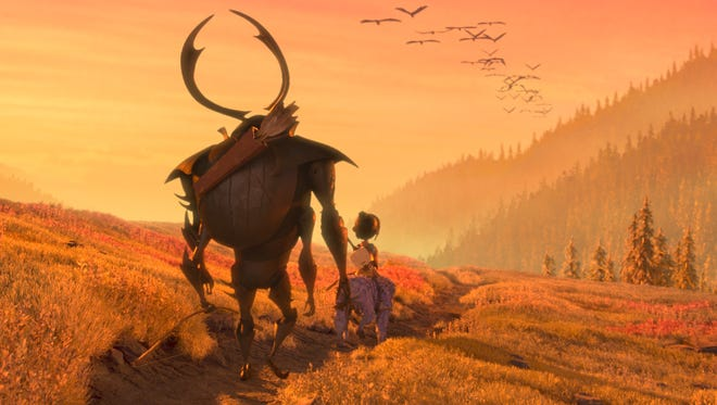 """Beetle, Kubo, and Monkey set off on a path in """"Kubo and the Two Strings."""""""