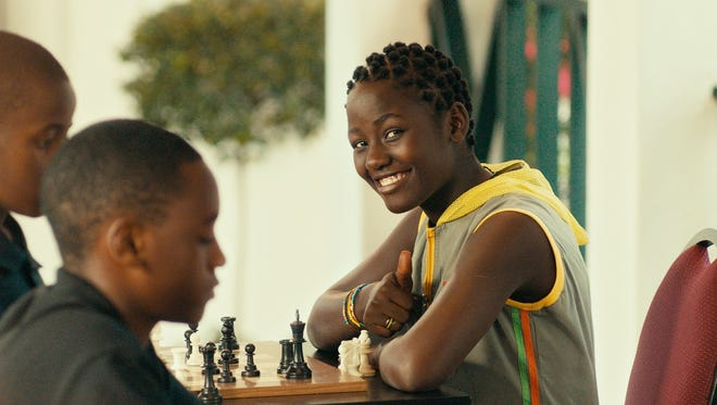 "In this image released by Disney, Madina Nalwanga appears in a scene from ""Queen of Katwe."" (Edward Echwalu/Disney via AP)"