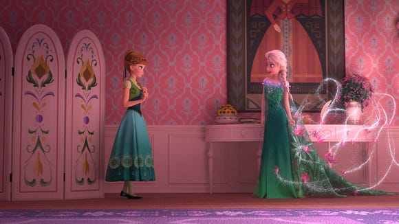 Anna and Elsa (L-R) in the short film 'Frozen Fever.'