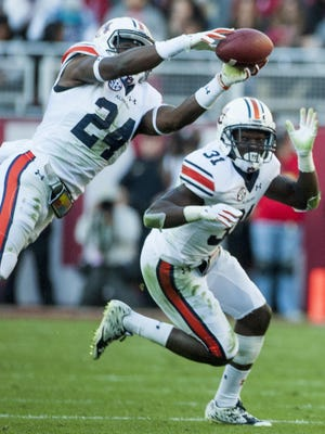 Auburn defensive back Daniel Thomas (24) intercepts a pass against Alabama during the Iron Bowl at Bryant Denny Stadium in Tuscaloosa, Ala. on Saturday November 26, 2016. (Mickey Welsh / Montgomery Advertiser)