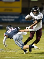 Navarre High School's Dante Wright, (No. 5) gives Gulf