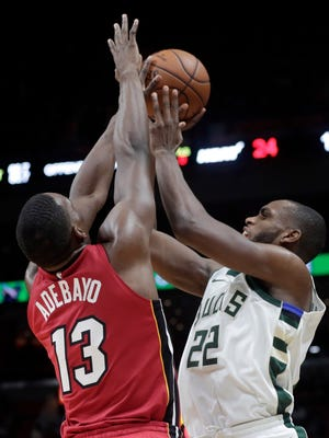 Khris Middleton (right) and the rest of the Bucks had a rough shooting performance against the Heat on Sunday.