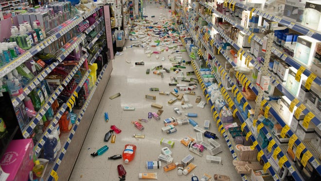 Merchandise is strewn across the floor in a La Habra Walgreens after a magnitudue-5.1 earthquake centered near La Habra on March 28, 2014.