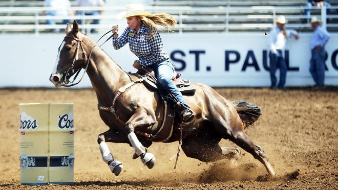 Catch barrel racing nightly at the St. Paul Rodeo.