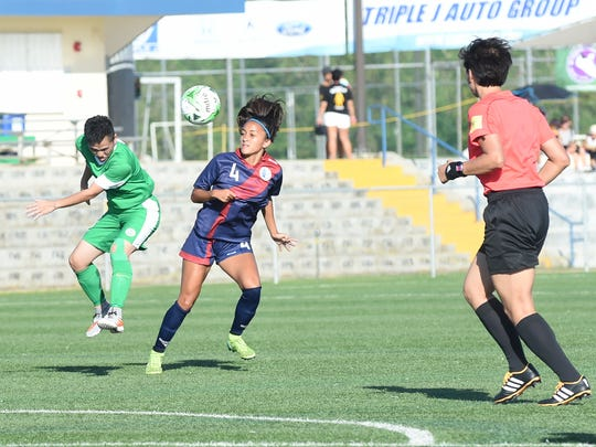 The Masakåda, the Guam women's national soccer team, plays Macau-China in an EAFF E-1 Football Championship Round 1 game at the Guam Football Association National Training Center on June 29.