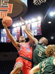 Louisiana Tech senior guard Alex Hamilton drives to the basket Saturday against UAB. The Bulldogs won 86-76.