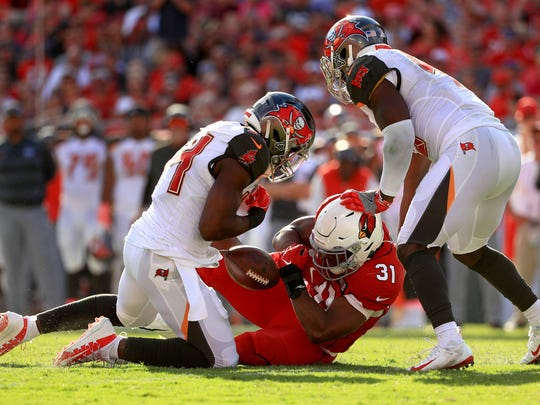 TAMPA, FLORIDA - NOVEMBER 10: David Johnson #31 of the Arizona Cardinals drops a pass during a game against the Tampa Bay Buccaneers at Raymond James Stadium on November 10, 2019 in Tampa, Florida. (Photo by Mike Ehrmann/Getty Images)