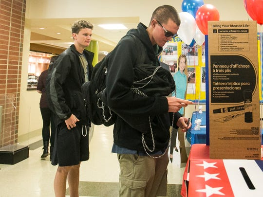 York College freshman Greg Williams, right, of Ridgecrest, California, makes his mock election vote, by selecting Donald Trump as his choice for President on Tuesday, Oct. 4, 2016. Amanda J. Cain photo