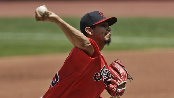 Cleveland Indians starting pitcher Carlos Carrasco delivers in the first inning in a baseball game against the Kansas City Royals on Sunday in Cleveland.