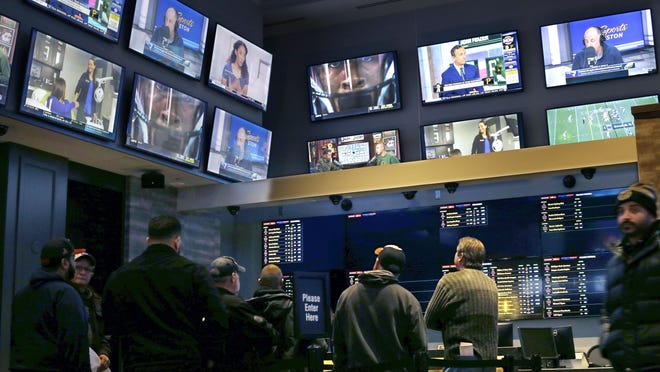 Bettors watch the action in Twin River Casino in Lincoln in November.