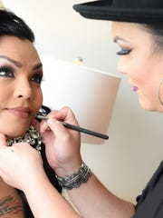 Jaryna Balbas, Miss Pacificana 2015, gets her makeup done by artist Reena Maanao at the Dusit Thani Guam Resort on Oct. 14.