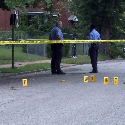 Police investigate the scene of the city's seventh shooting in roughly 11 hours.