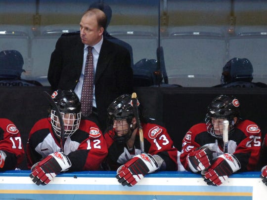 St. Cloud State head coach Bob Motzko and players on the bench watch during the final minutes of a loss to Maine in the NCAA tournament in 2007.