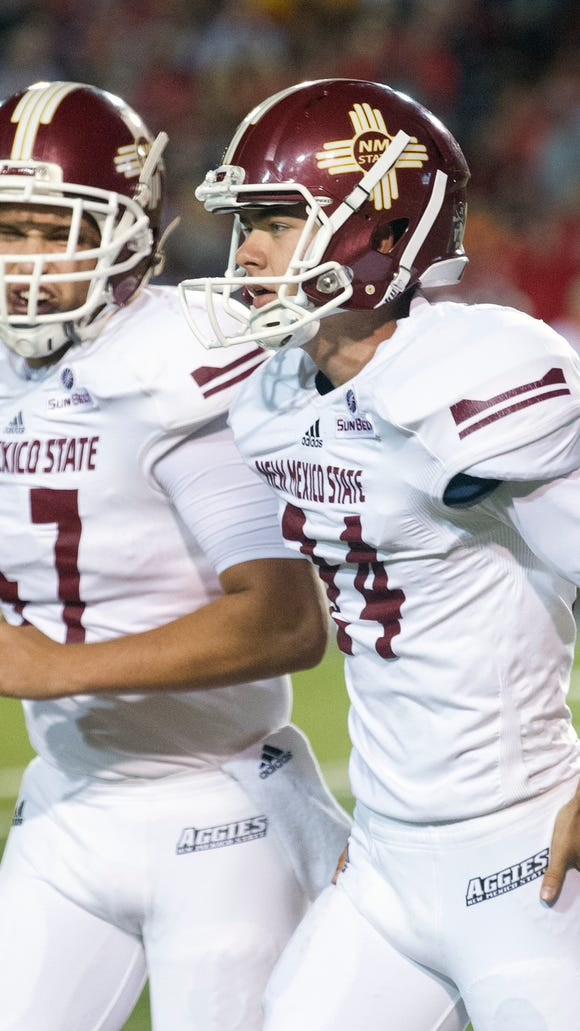 Aggie Kicker Parker Davidson gets congratulated by holder Andrew Kenney as he runs off the field after a 25 yard field goal.