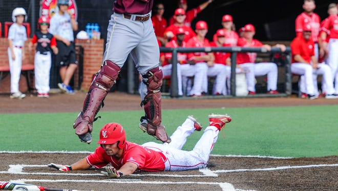 Brenn Conrad slides home as the Cajuns beat ULM 8-2 Friday in the resumption of a game suspended by lightning Thursday.