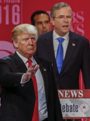 Donald Trump and Jeb Bush after a presidential primary debate in Greenville, S.C., on Feb. 13, 2016.