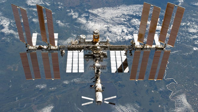 The International Space Station is featured in this image photographed by an STS-133 crew member on space shuttle Discovery after the station and shuttle began their post-undocking relative separation on March 7, 2011.