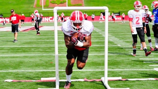 Ragin' Cajuns freshman running back Jordan Wright runs a drill before Saturday's scrimmage.