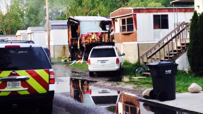 A mobile home on Amber Drive in Covington went up in flames as police arrived to investigate a man being shot early Monday.