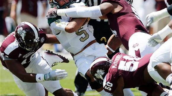 Preston Smith and Benardrick McKinnney sack UAB quarterback Cody Clements in Mississippi State's 47-34 win.