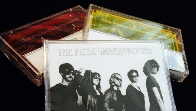 """A demo from the Pizza Underground is available on """"cheezy yellow"""" or """"pizza sauce red"""" cassette."""