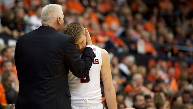 Oregon State head basketball coach Wayne Tinkle embraces his son, Tres, during a game against USC at Gill Coliseum on Jan. 24, 2016. The Beavers won 85-70.