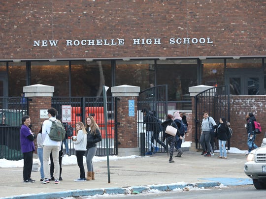 New Rochelle high school students arrive for class