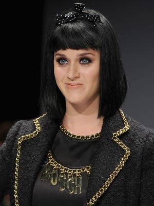 The multi-talented Katy Perry: She models, as in the other day in Milan, and she practices midwifery, too.