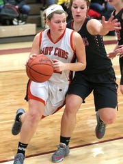 Lucas' Jessie Grover dribbles the ball during the district