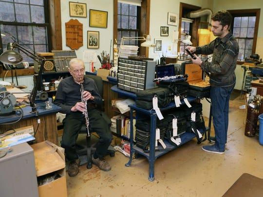 Paul Laubin plays a few notes on his handmade Oboe as his son Alex assembles an instrument at their company, A. Laubin, Inc. in Peekskill.