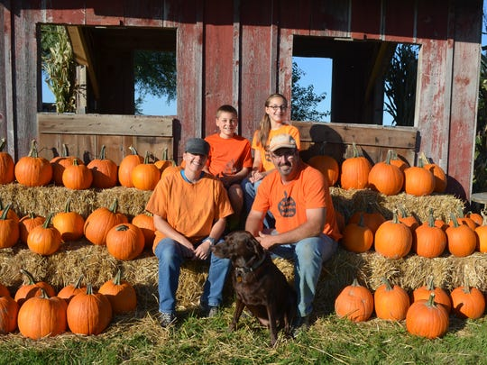 Four of the five members of the Colony family are pictured Tuesday at the family's farm in North Liberty. Pictured are Katie and Dean, and children Megan, 12, and Eric, 10. Not pictured is 10-year-old Alison.