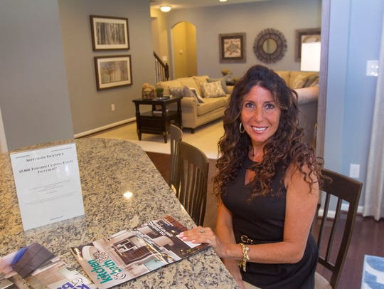 Joy Berarden of Keller Williams inside a home for sale