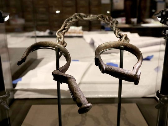 A pair of slave shackles are on display in the Slavery and Freedom Gallery in the Smithsonian's National Museum of African American History and Culture during the press preview on the National Mall.