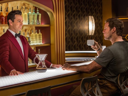 "Jim (Chris Pratt) chats with bartender Arthur (Michael Sheen) in Columbia Pictures' ""Passengers."""