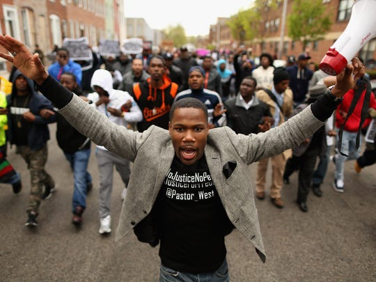Hundreds of demonstrators march toward the  Baltimore Police Western District station during a protest against police brutality and the death of Freddie Gray in 2015.