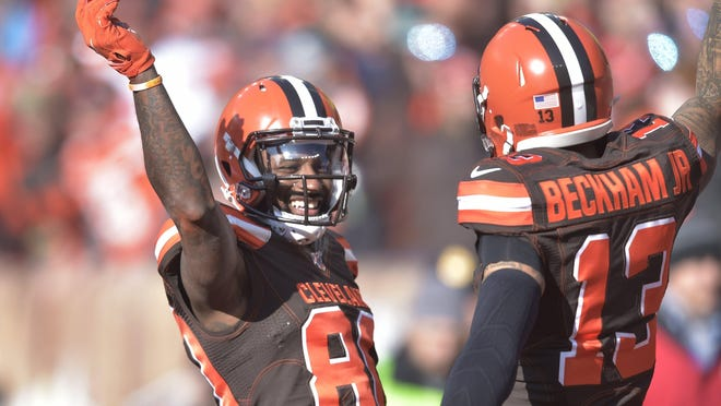 Cleveland Browns wide receiver Jarvis Landry (80) celebrates with Cleveland Browns wide receiver Odell Beckham Jr. (13) after Landry scored a 7-yard touchdown during the first half of an NFL football game against the Miami Dolphins, Sunday, Nov. 24, 2019, in Cleveland.