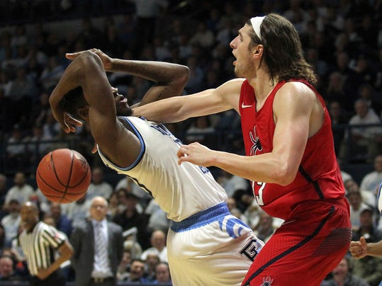 Rhode Island's Cyril Langevine, left, and Richmond's Grant Golden (33) battle for a rebound during the second half of an NCAA college basketball game Tuesday, Feb. 13, 2018, in Kingston, R.I. (AP Photo/Stew Milne)