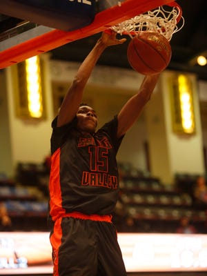 Spring Valley's Mavenson Thernelus (15) scores during the game against Rye in the challenge game at the18th Annual Slam Dunk Tournament at the Westchester County Center in White Plains on Dec. 29, 2016. Spring Valley won 60 - 46.