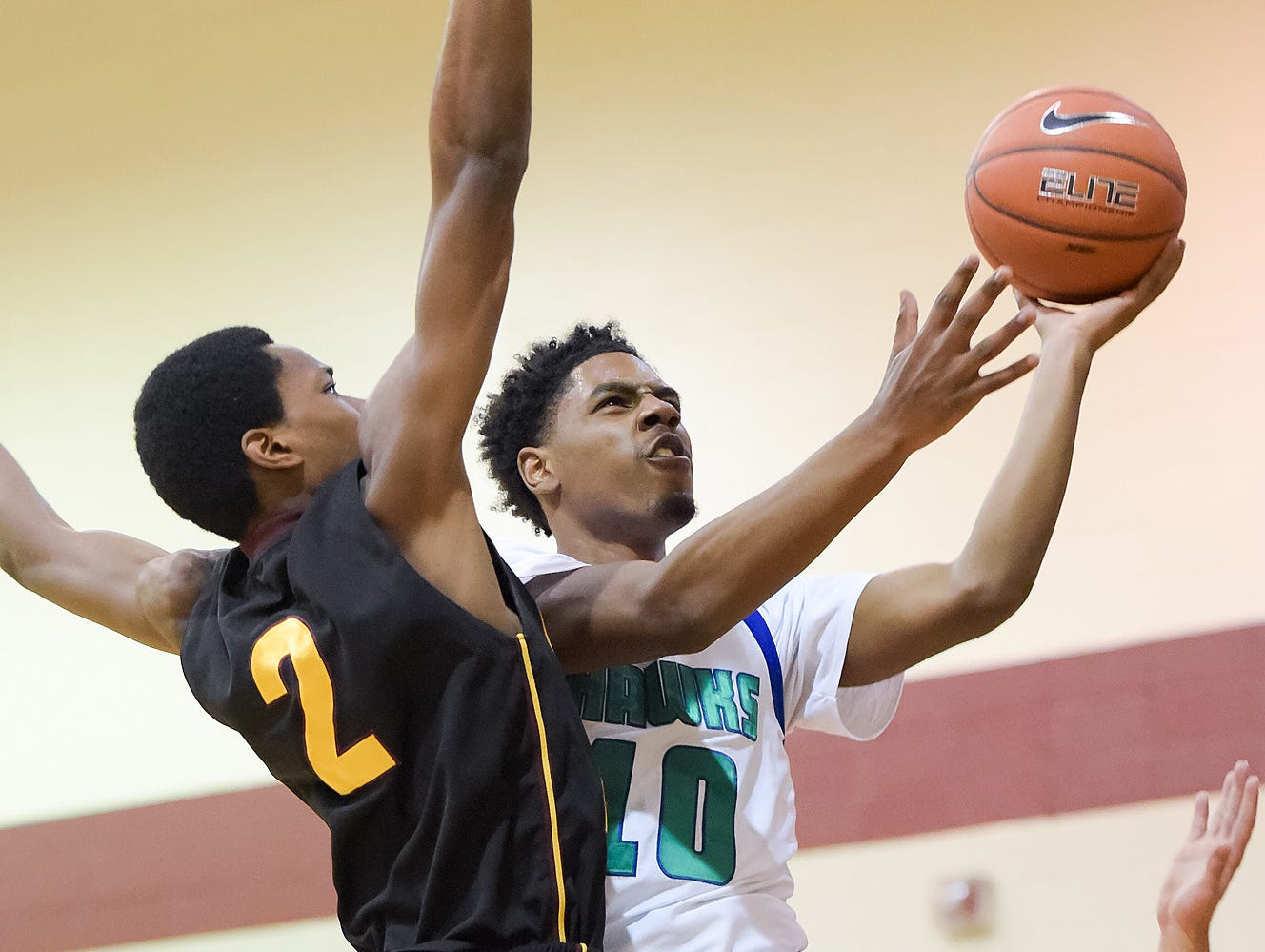 Lamar Hamrick (10) goes to the basket against Precious Achuwa (2) of Our Saviour Lutheran of Bronx, N.Y., at the Concord Classic on Monday.