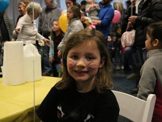 Myla Kovert, 8, of Republic, gets her face painted